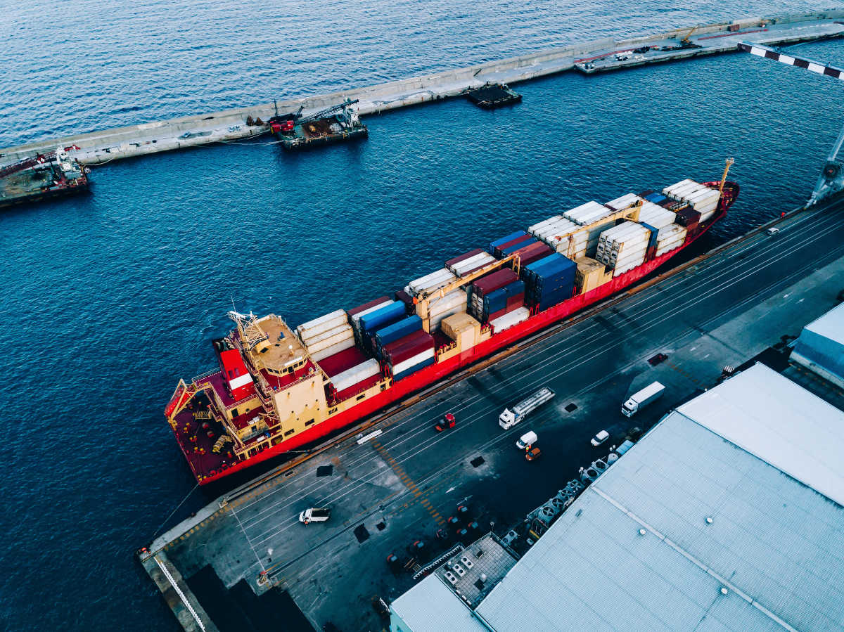 Aerial Top View Of Industrial Cargo Container Ship In Termina